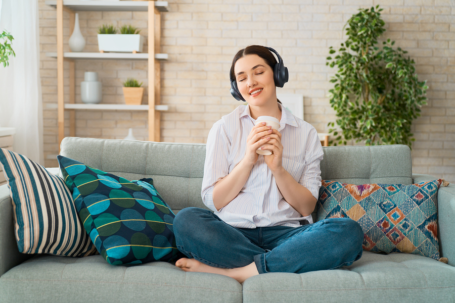 woman-smiling-listening-music-on-headphones